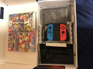 Barely used Nintendo switch with two games for Sale in Fort Drum, NY