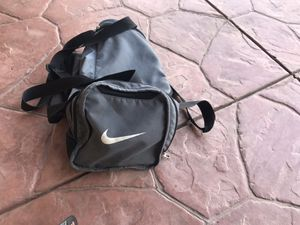 Youth soccer cleats sz 5, strap shin guards and nike duffle bag for Sale in Fresno, CA