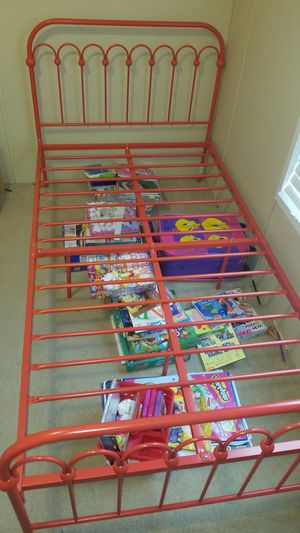 Red twin iron bed no mattress for Sale in Halifax, VA