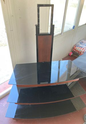 "Tv stand . Holds up 55"" TVs (doesn't come with the tv mounts) for Sale in Manteca, CA"