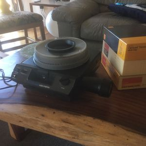 Kodak carousel slide projector with 3 trays or 180 slides and 1 for 80 slides for Sale in Del Mar, CA