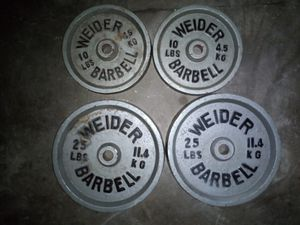 70 lb of weight 1 inch hole Weider barbell for Sale in Lebanon, PA