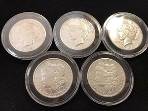 Silver coins 3 peace dollars and 2 Morgans for Sale in Chino, CA
