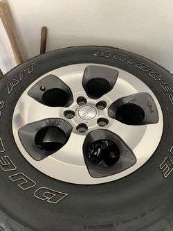 5 including spare stock wheels and tires off of a 2017 Jeep Sahara P255/70R18 for Sale in Reedley,  CA