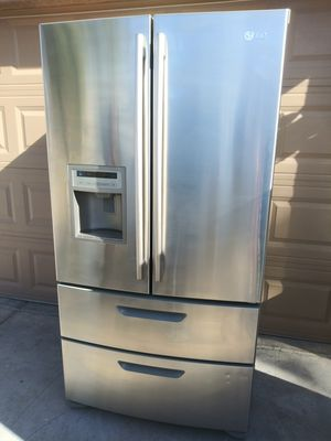 LG stainless steel kitchen appliances four door French door refrigerator electric double oven range stove and over the range microwave for Sale in Phoenix, AZ