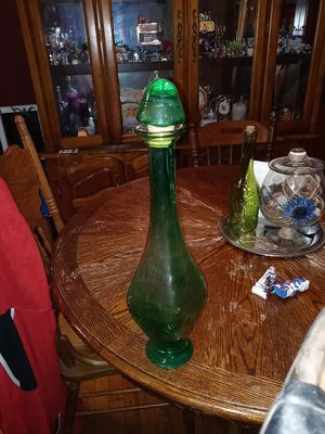 A large green glass bottle w/ top for Sale in Dayton, OH