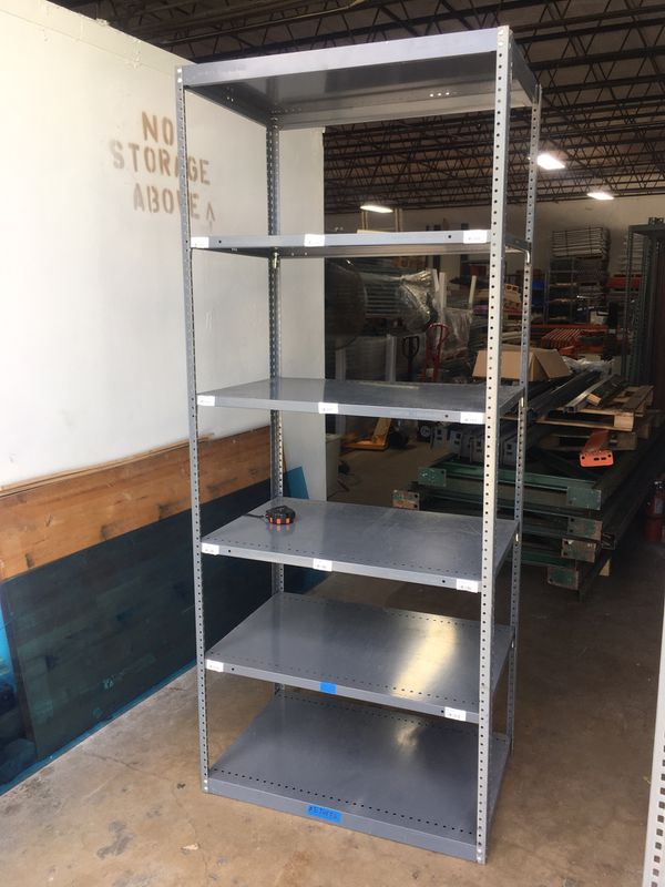 "Metal shelving used 87""H x 24"" D x 36"" W with six shelves"