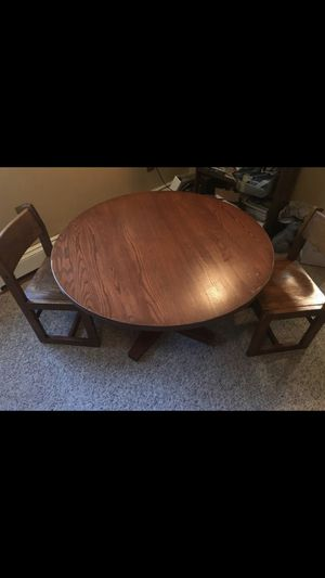 Kids wooden round table and three matching chairs. for Sale in Brecksville, OH