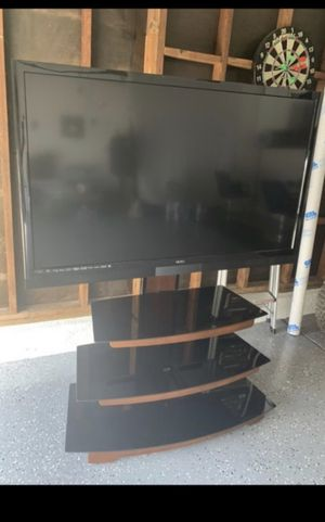 55in Tv and tv stand for Sale in Hayward, CA
