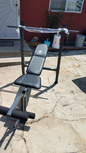 Standard bench press with leg developer and bar for Sale in Montebello, CA