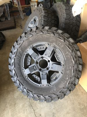 18 inch Rockstar's on 35x12.5x18 Gladiator M/T tires. These are MEAN aggressive tires and wheels for $1100 tires with plenty of tred. 10/32 tred app for Sale in Portland, OR
