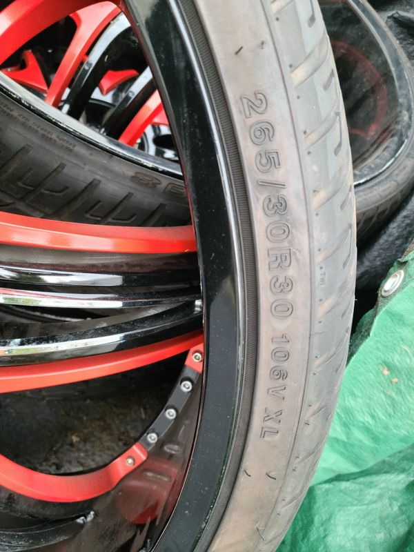30x10 Diablo Morpheus Black with Red Accents Rims with Lionhart 275x /30r30 Tires