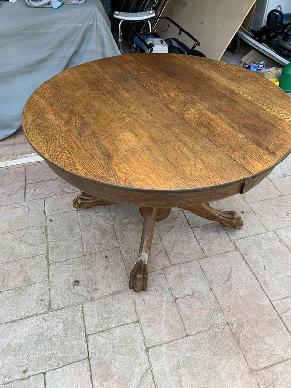 Antique Oak captains table w/two leaves
