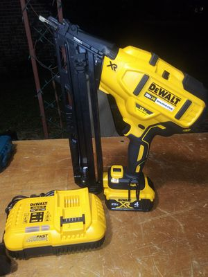 $300. Used-like-new. DEWALT 20-V. XR 15-Ga. Angled Finish Nailer with. 4Ah Battery Pack and Charger. for Sale in Morrow, GA