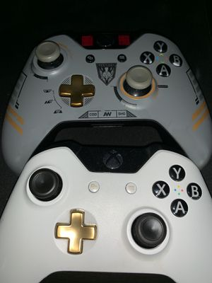 2 Xbox one controllers (one has grips) for Sale in Detroit, MI