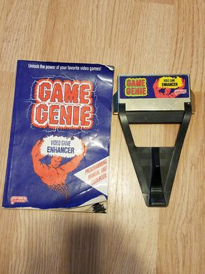 Game genie with code book for Sale in Cardington, OH