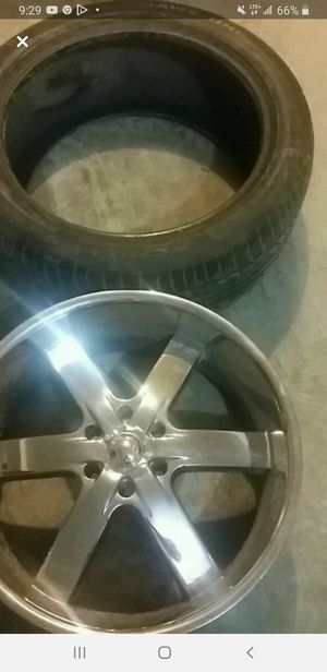 22 inch rim and tire for Sale in Elizabeth, NJ