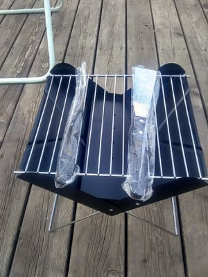 Foldable bbq grill,and two tools,with a canvas bag to carry. Unused. for Sale in Brown City, MI
