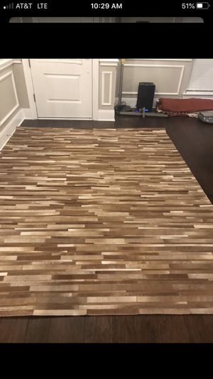 Cowhide Beautifull rug about 8'x10' like new used as decent for Sale in Arlington, TX