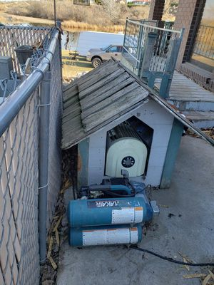 Free extra large doghouse for Sale in Kennewick, WA
