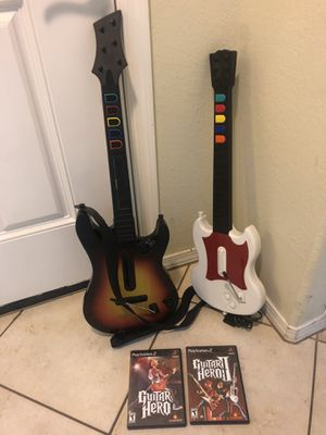 Playstation 2 PS2 2 Guitar Hero guitars & 2 games. All works well. for Sale in Phoenix, AZ
