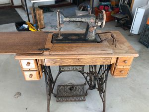 Vintage singer sewing machine and table for Sale in Ithaca, NY