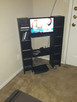 Play station 2 and entertainment center a d 2 games $30 dollars must go asap for Sale in Houston, TX