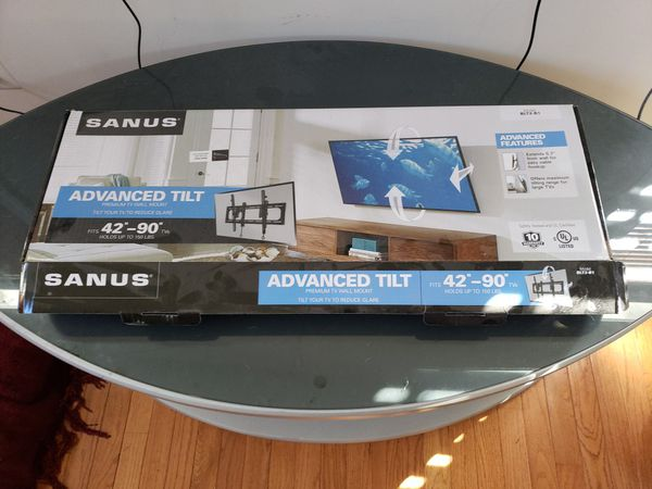 Samsung flat-screen TV with mount and entertainment center