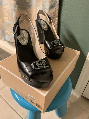 Michael Kors Charm Sling shoes Color: Black/Silver Leather Size: 8.5 EXCELLENT CONDITION Pick up only 77090 area No Trades for Sale in Houston, TX