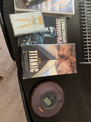 Looking to get rid of random stuff. We have a CD player, vhs tapes, playing cards, Madonna tape and a CD rack. for Sale in San Diego, CA