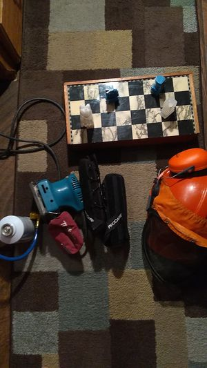 Makita Palm sander,chess set two full cans of freon ,braces for carple tunnel,hard hat with ear and face prtection for Sale in Flagler Beach, FL