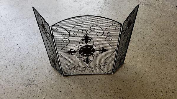 Small black metal fireplace screen
