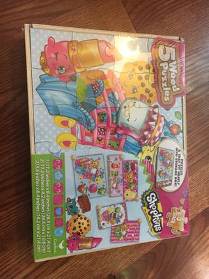 Shopkins 5 wood puzzles comes with storage box, never opened for Sale in Westerville, OH
