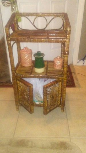 Small beautiful wicker cabinet with storage area great for small areas for Sale in Port Charlotte, FL