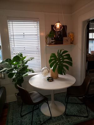 IKEA Docksta round dining table and 2 brown leather and metal dining chairs for Sale in St. Petersburg, FL