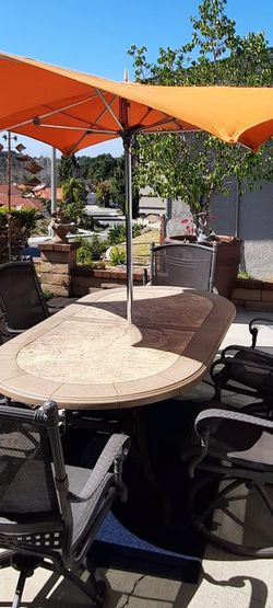 Custom Made TROPITONE Stoneworks PATIO TABLE and 6 WIDE Swivel & ROCK Metal Outdoor Dining Chairs (NO CUSHION NEEDED) for Sale in Chino Hills,  CA