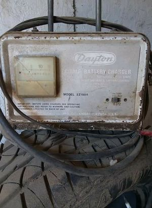 Batter charger n BBQ grill for Sale in Kerman, CA