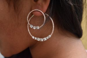 Front and back side hoop earrings with American diamonds for Sale in Pleasanton, CA