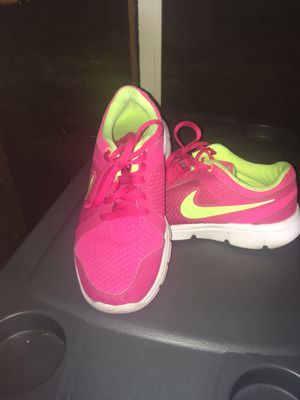 Yellow and pink nike shoes size 3 1/2 for Sale in Lodi, CA