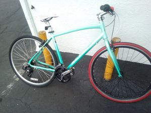 Raleigh Hybird mountain 27inch rim bike rides great for Sale in Montclair, CA