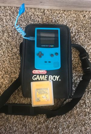 Game boy color with carrier case/light/ and original Pokémon yellow for Sale in Fountain, CO