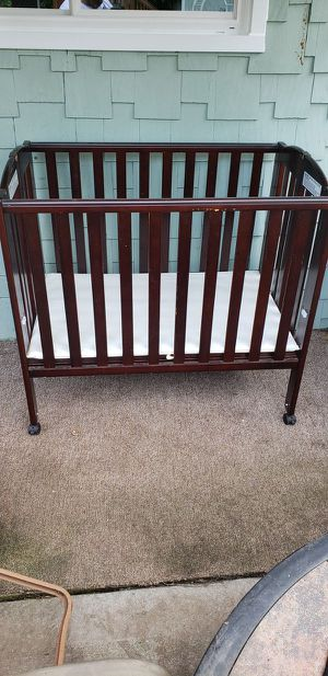 Portable Wood Crib - Foldable (With a Crib Mattress) for Sale in Lorain, OH