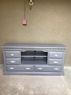 """TV Stand freshly refinished in Gray with silver handles. 67"""" L x 18"""" W x 33"""" Hgt. 2 bottom Large drawers are for show. Solid Wood. for Sale in Mesquite, TX"""