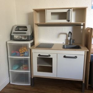 IKEA play kitchen with dishes/food for Sale in Manteca, CA
