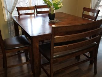 Ashley furniture convertible table, can be small rectangle or large square for Sale in Yelm,  WA