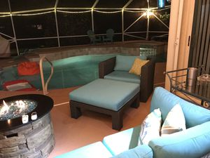 Outdoor wicker rattan 5 piece sectional couch with extra think Sunbrella cushions. Also chair and ottoman. Covers for all. Have always been under co for Sale in FL, US