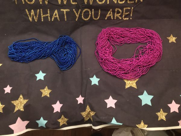 Gender reveal banner and necklaces