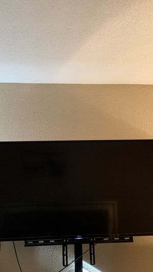 55 inch roku tv with stand for Sale in Houston, TX