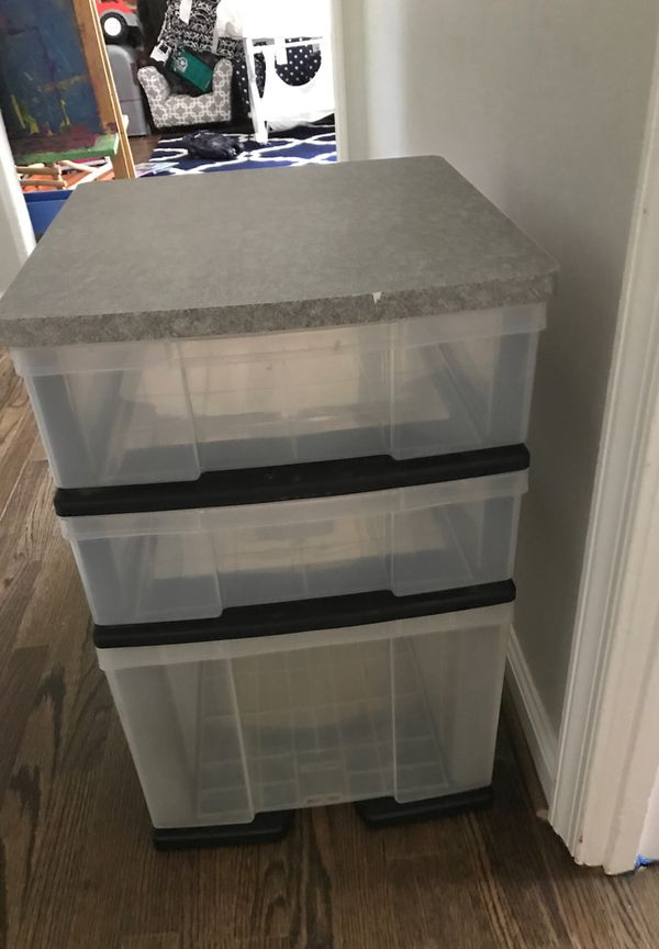 Hard plastic drawers.