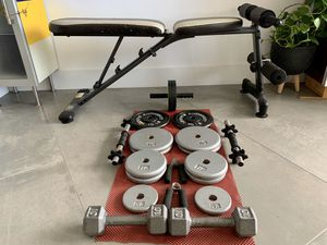 Adjustable Multi-workout weight bench and (22) Weight Plates for Sale in Aventura, FL